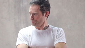 The Invisible Hand Star Justin Kirk Reflects on Angels & Why Game-Changers Aren't Always Evident