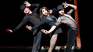 Bianca Marroquin as Roxie Hart and the cast of Chicago