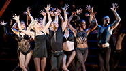 Amra-Faye Wright as Velma Kelly and the cast of Chicago
