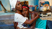 Akosua Busia as Rita and Lupita Nyong'o as The Girl in Eclipsed