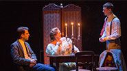 Zachary Quinto as Tom, Cherry Jones as Amanda and Brian J. Smith as the Gentleman Caller in The Glass Menagerie.