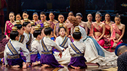 Marin Mazzie as Anna and the cast of The King and I