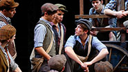 Corey Cott and the newsboys in Newsies.