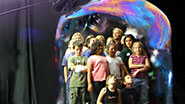 Children are put inside a giant bubble during off-Broadway's Gazillion Bubble Show.