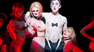 Alan Cumming as the Emcee and the Kit Kat Klub Girls in 'Cabaret'
