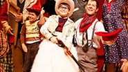 Johnny Rabe as Ralphie and the cast in A Christmas Story: The Musical.