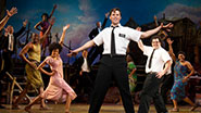 Andrew Rannells and the cast of The Book of Mormon.